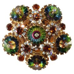 The green stones with scalloped edges in this brooch are Swarovski margaritas.