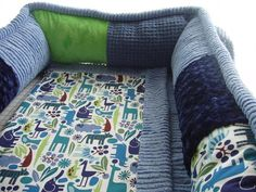2D Zoo Crib Collection, 4pc crib bedding, diaper stacker, and pillow,  via Etsy.