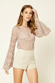 Forever 21 Contemporary - A semi-sheer lace top featuring long bell sleeves and a round neckline.