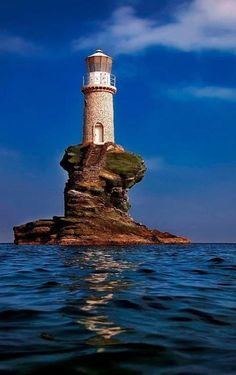 "orchidaorchid: "" Tourlitis lighthouse, in Andros Island (Cyclades),Greece // by Antonis Lemonakis "" A Just say WOW Photo - Andros Island, Greece Saint Mathieu, Lighthouse Pictures, Reisen In Europa, Beacon Of Light, Light Of The World, Water Tower, Am Meer, Belle Photo, Places To See"