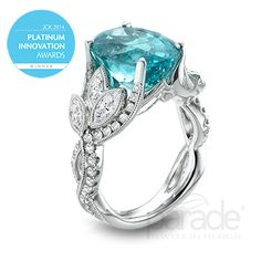 Buyer's Choice at the 2014 Platinum Innovation Awards! Meandering diamond-set vines and leaves showcase a watery blue 7.03 carat Paraiba tourmaline.