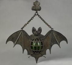 1930's cast iron bat hanging light with green glass...so love...