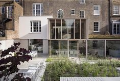 Opening up a London town house. East London House extension by David Mikhail Architects Design Studio, House Design, 19th Century London, Glass Extension, Brick Extension, Extension Ideas, Villa, Brick Garden, Georgian Homes