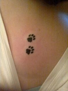 This is the tattoo I plan on getting, except it will be just one paw and it will be my dog's actual paw print :)