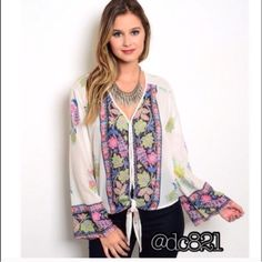 Boho Bell Sleeve Blouse Gorgeous boho bell sleeve blouse with toe at waist. Featuring a leafy floral design. Made of a cotton chiffon blend. Size L Tops Blouses
