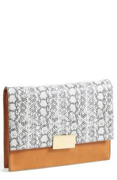 Free shipping and returns on Vince Camuto 'Caleb ' Clutch at Nordstrom.com. Elevate your street style with a clean, classic clutch featuring goldtone hardware and an exotic contrast flap along with a versatile drop-in chain strap.