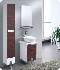 The Adour Dark Walnut Vanity is 16″ deep and only has one leg making it a very unique vanity. Available with optional side cabinet. $599.00.