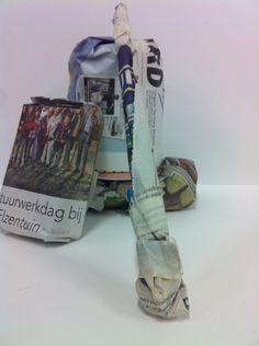 De 1e opdracht  Ingepakt met kranten