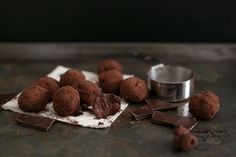 Simple Vegan Chocolate Truffles made with Dark Chocolate, Coconut Cream, Maple Syrup Sea Salt, Espresso and Vanilla Bean. Easy to make, decadent, yum. #CHOCOLATE #vegan #delicious #truffles #simple #dairyfree #easy #coconut #darkchocolate #recipes