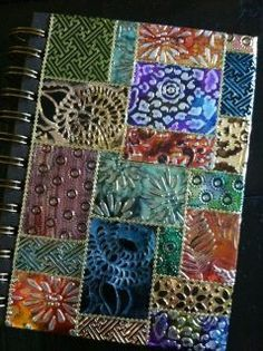 This beautiful journal was made by Els using Shimmer Sheetz which have been run thru embossing folders and rubbed with alcohol ink.