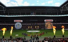 Manchester United and Wigan walk out onto the pitch at Wembley