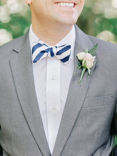 Navy striped bow tie | Read More: http://www.stylemepretty.com/2014/09/05/peach-navy-flat-creek-country-club-wedding/ | Photography: Amy Arrington Photography - amyarrington.com