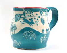 This is a terrific mug AND Im wild about it in these colors - turquoise, lined with orange! The design is based on Mexican folk art pottery.…