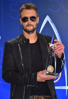 Eric Church Photos Photos - Eric Church poses with award for the Album of the Year at the 50th annual CMA Awards at the Bridgestone Arena on November 2, 2016 in Nashville, Tennessee. - The 50th Annual CMA Awards - Press Room