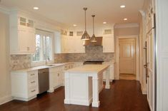 L-shaped kitchen, white cabinets