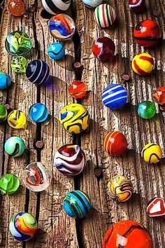 Marbles on wooden board. Photo by Garry Gay on Getty Images.