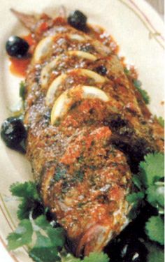 Grilled Fish with Moroccan Charmoula Vinaigrette By Chef Heidi Krahling, San Anselmo, CA Chef's Tip: Swordfish, Tuna, and whole Snapper are perfect for this spicy vinaigrette, which is used first as a marinade.