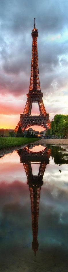 The Eiffel Tower in Paris, France - reflected in the pool below at sunset - Long, Tall, Vertical Pins. Paris Eiffel Tower