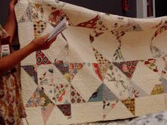 """A """"potholder"""" quilt, pieced and quilted in pieces like potholders, then sewn together"""