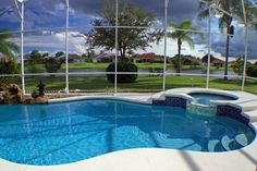 Screened in pool in suburb with hot tub and small garden looking out on sprawling lawn, trees and waterway. pool ideas 45 Screened-In and Covered Pool Design Ideas Swimming Pool Enclosures, Small Swimming Pools, Small Pools, Tub Enclosures, Hot Tub Backyard, Backyard Pool Landscaping, Landscaping Ideas, Backyard Ideas, Patio Ideas