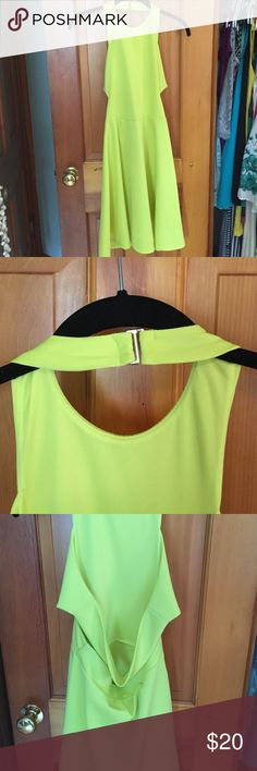 Green/yellow dress Never worn! This dress clasps around the neck and has an open back with one strap across the middle. Has a minor tear in the seam (picture). Dresses