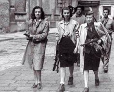 Female Italian partisans associated with the Partito d'Azione, a liberal socialist political party, during the liberation of Milan