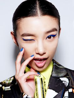 Electric blue cat-eye liner + nails