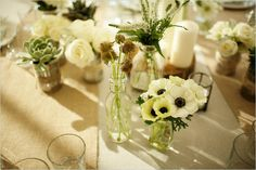 glass jars + tin cans + twine = rustic center pieces!