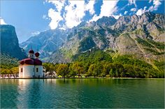 UtArt - St. Bartholomä am #Königssee St. Bartholomew's (German: St. Bartholomä) is a Roman Catholic pilgrimage church in the Berchtesgadener Land district of Bavaria in Germany. It is named after Saint Bartholomew the Apostle (Bartholomäus in German), patron of alpine farmers and dairymen. The church is located at the western shore of the Königssee lake, on the Hirschau peninsula. It can only be reached by ship or after a long hike across the surrounding mountains.#wanderlust  #wallart