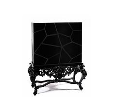 VICTORIA is a modern baroque cabinet in black glass, hand carved in true baroque style.