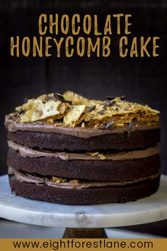 Chocolate Honeycomb Cake - Rich layers of spongy #chocolatecake, sandwiched between a thick fudgy chocolate buttercream and topped with shards of golden homemade #honeycomb make this #dessert the ultimate in party #cakes.