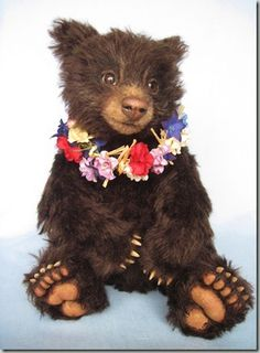 Realistic Style Teddy Bear...oh so real looking but who would put the flowers  on a real bear ?  love this