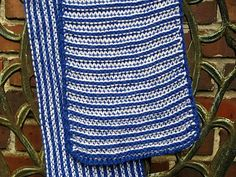 """Named for that unexpected play that can make or break a game, the stitch pattern used in this scarf will have many people scratching their heads, wondering how you did it. But when you know the """"trick"""" you'll be amazed at how easy this is to work. It is a simple all knit pattern where you only work with one color at a time. Yet it creates a 2-color, textured, reversible, and non-rolling fabric that is just perfect for a scarf, without the stiffness of garter stitch. If you can make a knit…"""