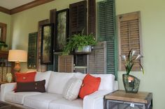 Living Room  The wall collage was made from mounted vintage shutters. I loved they way they layered them perfectly. It even makes me wonder if we have any of those hiding out in the basement or garage.....