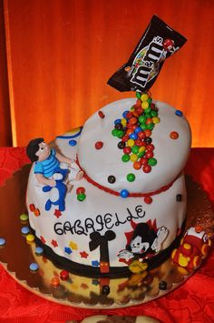 Mom wants Mickey Mouse, Dad instead wants M&M = Gabrielle's 1st Bday cake