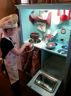 Try making a DIY play kitchen!  We are so happy we did & didn't choose to buy our grandaughter a commercial made one!