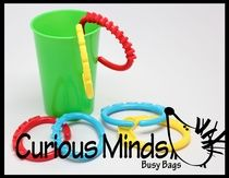 1 Year Old Busy Bag: Cup and Links  This early toddler busy bag is so simple but so fun for one year olds. It is simply a cup and large co...