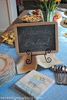 Casual Baby Shower Brunch, at Serenity Now.   Like the framed chalkboard in a plate stand.