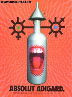 Absolut Adigard.    Bright orange with face, mouth in bottle