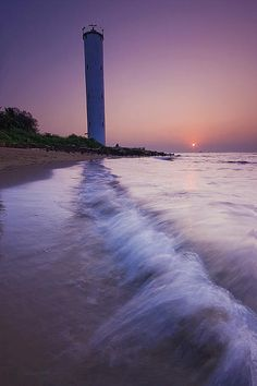 Lighthouse Beach - Goa, India.  Go to www.YourTravelVideos.com or just click on photo for home videos and much more on sites like this.