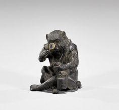 "NTIQUE JAPANESE BRONZE MONKEY Antique Japanese bronze okimono; of a seated monkey, studying a netsuke and inro with crest of Hayashi family, through a magnifying glass, signed Yoshitani; Circa 1865; H: 3 1/8""; Estate of Dr. Kyoshi Hosai, Honolulu; Sotheby's Parke Bernet, Oct. 14, 1975"