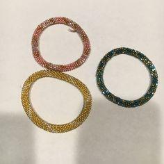 Set of 3 Bracelets Beautifully hand-beaded bracelets.  Set of 3 - pink, yellow, & blue.  Not stretchy! Jewelry Bracelets