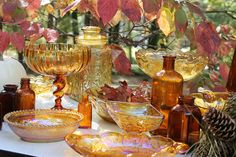 inspiration for a fall wedding...fall leaves so pretty with amber and brown glassware. rent from southernvintagegeorgia.com