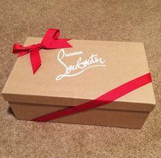 Louboutin brown shoe box, red bow