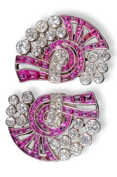 A pair of Art Deco ruby and diamond double clip brooches, of abstract scroll design and set with graduated circular-cut diamonds and buff-top rubies in platinum, each clip wide Jewelry Design Earrings, Art Deco Earrings, Art Deco Jewelry, High Jewelry, Gemstone Jewelry, Gold Jewellery, Jewelry Rings, Silver Jewelry, Month Gemstones