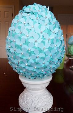 DIY - Easter Flower Paper Egg - Use a foam egg, covered in paper flowers made by a Martha Stewart hydrangea punch. Use two different shades of scrapbook paper, stack the punched flowers and stick on the egg using straight pins with pearls on the ends. Start pinning at the top of egg and move down.