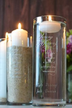 Keep loved ones who can't be present on your wedding day close to everyone's heart with a In Loving Memory glass memorial candle cylinder custom engraved with each name of those who are with you in spirit and thought. Add a pillar candle, sand, or water and a floating candle to light in memory of family and friends during your wedding ceremony and reception. This memorial cylinder keepsake can be ordered at…