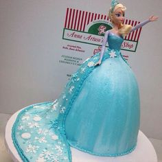 Elsa princess doll cake with Cape. Frozen birthday cakes. Frozen party ideas.
