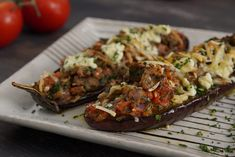 Little Shoes – Eggplant Halves Baked With Three Cheeses And Tomato - Diane Koc. - Little Shoes – Eggplant Halves Baked With Three Cheeses And Tomato – Diane Kochilas - Eggplant Dishes, Baked Eggplant, Eggplant Recipes, Stuffed Eggplant, Ceramic Baking Dish, Cooking Tomatoes, Greek Cooking, Mediterranean Recipes, Greek Recipes