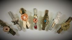 Altered clothespins with lace, metallic elements, flowers etc.